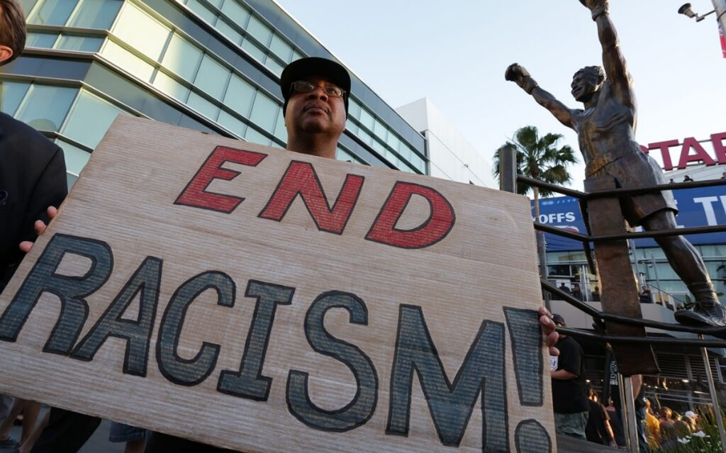 end racism protest sign